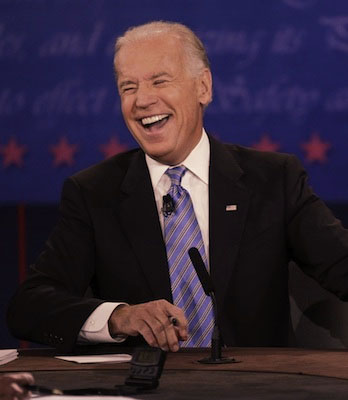 Joe Biden laughs hard.